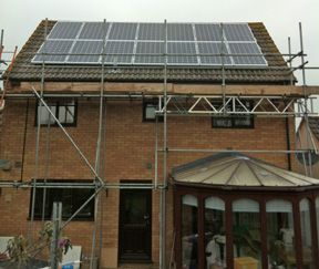 Solar panels on house with grey front