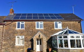 Solar panels on cottage style house
