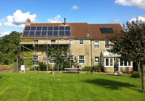 Solar panels on house with lawn